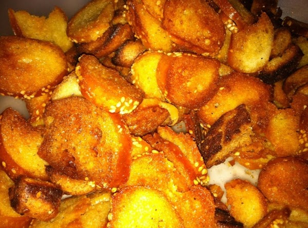 Remove from oven, turn the chips over and drain any oil that may be...