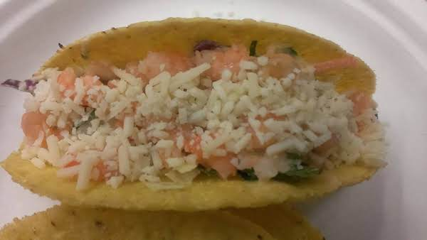 I Spooned The Slaw Mixture Into The Shell And Topped With Shrimp And Cheese For My Guinea Pigs.  The Recipe Says You Can Mix It All Together Because I Love Easy Dishes.  :)