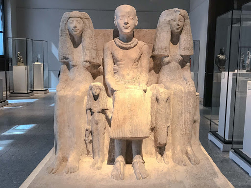 Family-group-of-Ptah-mai.jpg - Family group of Ptah-mai, chief of the Wab-priests of Ptah, during the dynasty of Ramses II, 1213-1279 B.C., at the Neues Museum in Berlin.