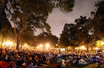 Photo: A crowd watches an outdoor movie