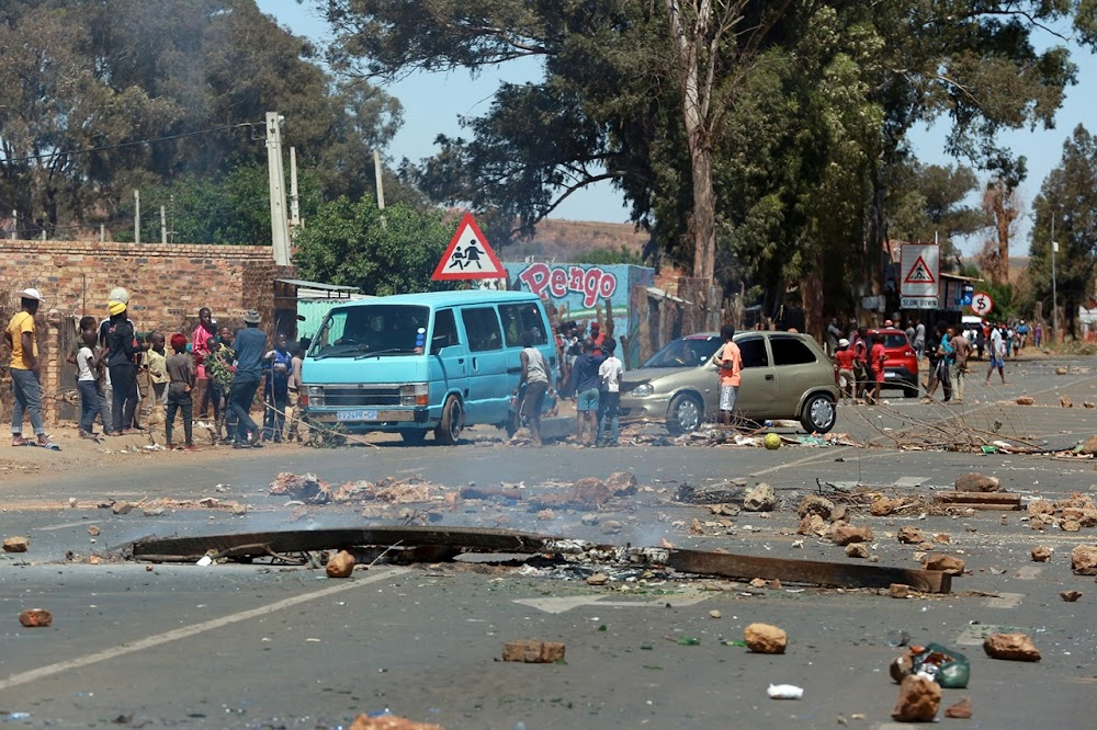 WATCH   Shots fired as police and protesters clash over evictions - TimesLIVE