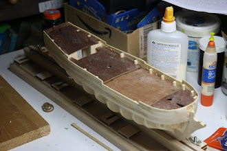 Photo: The first planking in progress - note use of wood filler to smooth the bow.