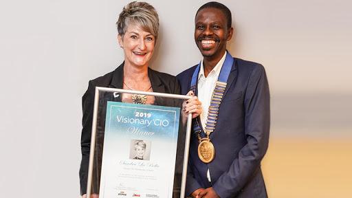 2019 Visionary CIO winner Sandra La Bella and IITPSA president Thabo Mashegoane.
