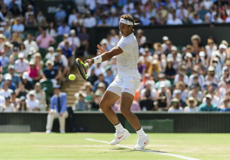 Rafael Nadal of Spain in action against Alex De Minaur in the third round of the gentleman's singles at the All England Lawn Tennis and Croquet Club on July 7, 2018 in London, England.