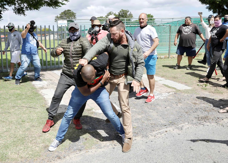 A fight breaks out between the Brackenfell community and EFF members outside Brackenfell High School in Cape Town.