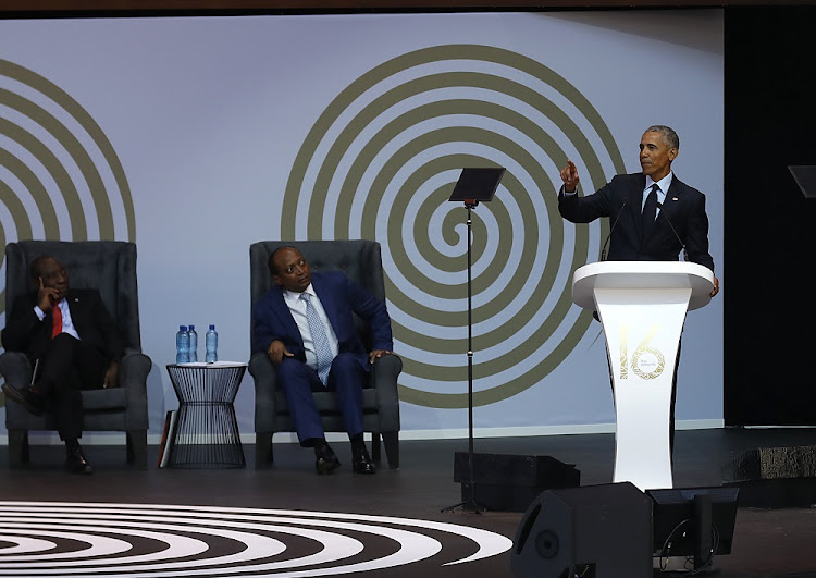 President Cyril Ramaphosa and businessman Patrice Motsepe listen as former U.S President Barack Obama delivers the 16th Nelson Mandela Annual Lecture.