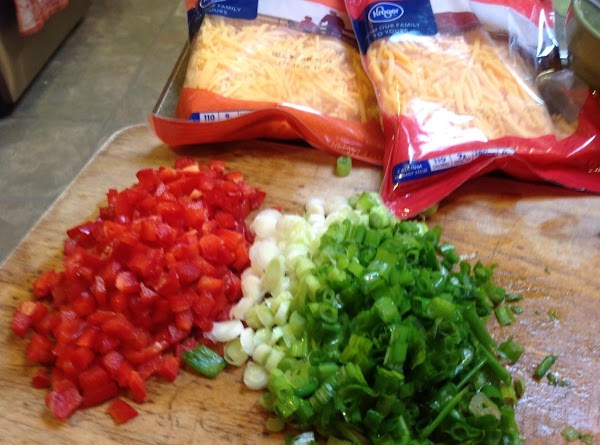 Chop red peppers, Green & red Onions. I don't show them in this picture,...
