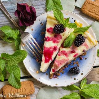 Blackberry Glazed Vanilla Cheesecake with Biscoff Crust.