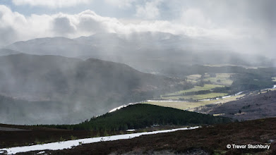 Photo: Snow showers over the River Dee obscure the view from Geallaig to Lochnagar