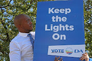 DA leader Mmusi Maimane unveils the party's new new election poster outside Megawatt Park in Sunninghill on Wednesday.