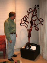 Photo: Rhapsody in Red -- an amazing turned (yes, that's right, TURNED) piece by Jerry Bennett, viewed by Bob Brulotte. There are 7000 turned segments in this sculpture.