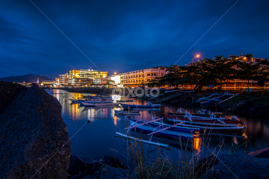 Harmony of Fisherman and the City by Robertho Ponomban - Landscapes Travel ( sunset, travel, landscapes, boat, city )