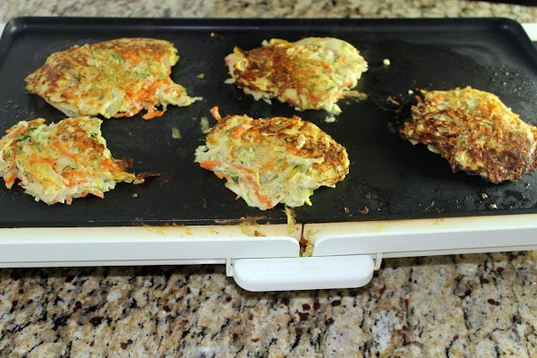 For each burger pour about 1/2 cup batter onto a hot griddle coated with...