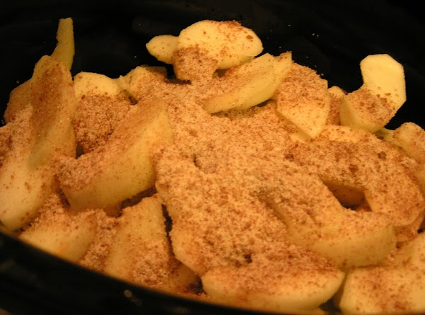 Place about 1/4 of the apples and pears in the crock pot, sprinkle 1/4...