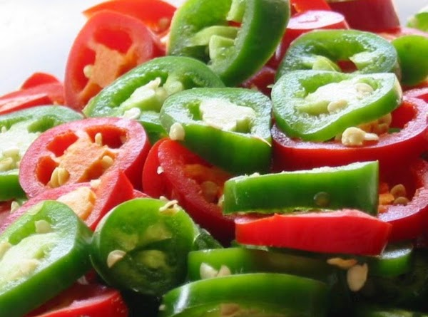 """Slice all of the jalapeno peppers in 1/4"""" rings and set aside. In a..."""