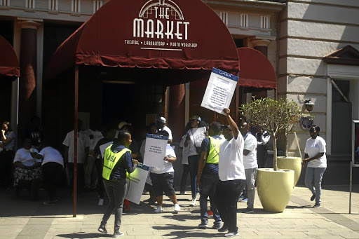 Members of the UASA protest outside of the Market Theater demanding their money.