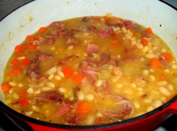 When beans are tender, remove the soup bone and cut off any meat and...