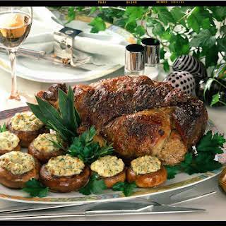 Roast Lamb with Stuffed Mushrooms and White Wine Sauce.