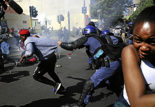 Police take action against students in Braamfontein, Johannesburg, during the #FeesMustFall protests at Wits University in 2016. File photo: ALON SKUY