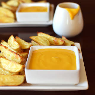 Dairy Free Cheese Sauce with Baked Baby Potato Wedge Fries.