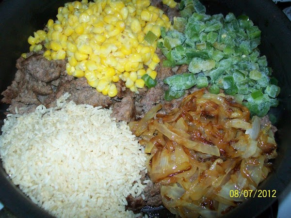 When that is all browned add the garlic, corn, peppers, onions, cumin, uncooked rice,...