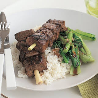 Grilled beef on lemongrass skewers with Asian greens.
