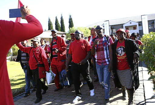 South African Communist Party (SACP) delegates sing as they arrive at the Birchwood Hotel in Boksburg where the party is holding its 14th national congress. The SACP will discuss whether to contest the 2019 elections independently from the ANC. Picture: MASI LOSI
