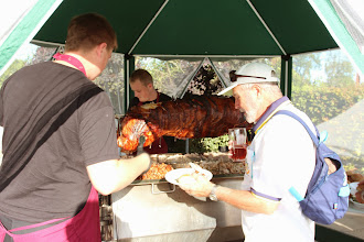 Photo: SPONSORS HAYWARDS BUTCHERS SPIT ROAST- COLIN ADMIRES THE CRACKLING