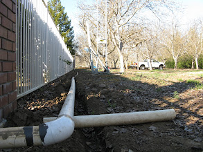 Photo: Ground view of the 3 inch pipe carring cables to new tower. Lots of digging on this job.