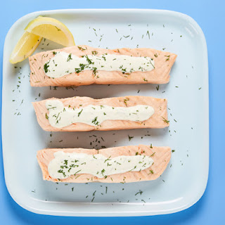 Chilled Poached Salmon with Lemon Dill Sauce.