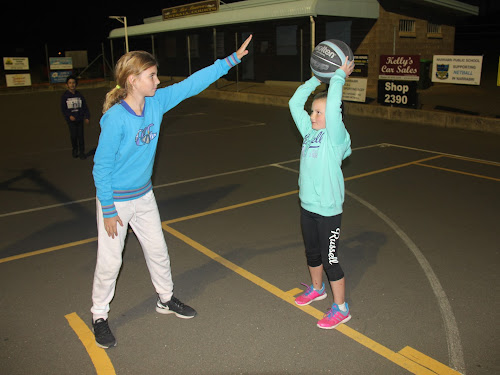 Junior basketballers Piper Williams and Chelsea Stait go one-on-one.