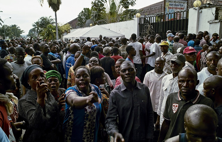 Opposition supporters shout slogans in Kinshasa, DRC. Picture: REUTERS/ROBERT CARRUBBA