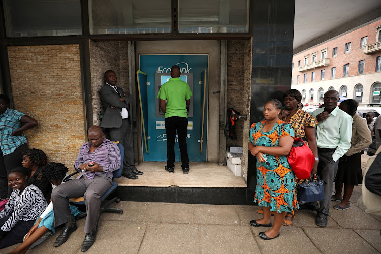 People queue outside a bank in Harare, Zimbabwe, on February 22 2019 as banks reopen after a bank holiday.
