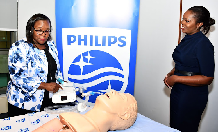 Agnes Khamisi, Clinical Applications Specialist Africa at Philips (L) and Dr. Muthoni Ntonjira, Country Manager, Philips (R) demonstrate how the new Philips E30 ventilator works during the official launch at the Philips office.