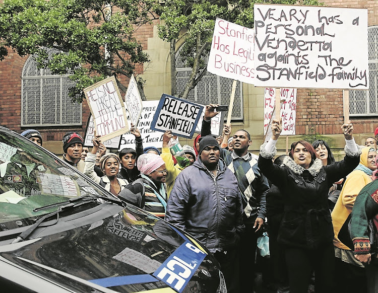 Protesters gather at Cape Town magistrate's court in 2014, when alleged 28s kingpin Ralph Stanfield made his first appearance on charges relating to a guns-to-gangs syndicate.