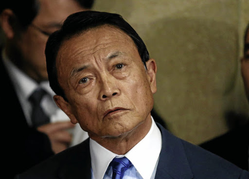 Japanese Finance Minister Taro Aso speaks to reporters in Tokyo on March 12 2018. Picture: REUTERS