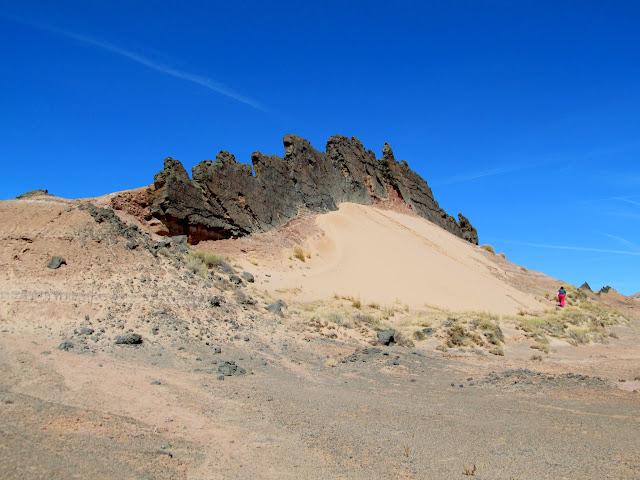 Volcanic dike and sand dune