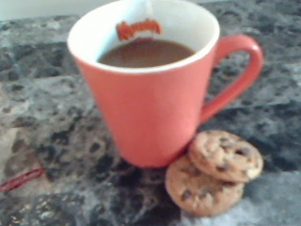 Add sugar and coffee single to a cup