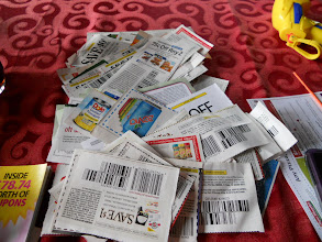 Photo: our pile of coupons to sort for the allforkids shop