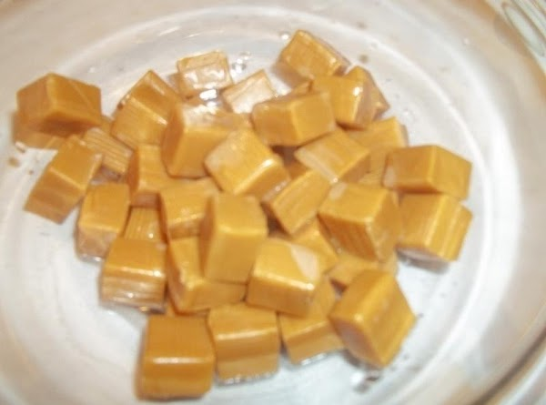 Prepare your caramel center first. Place caramels in a microwave safe bowl, along with...