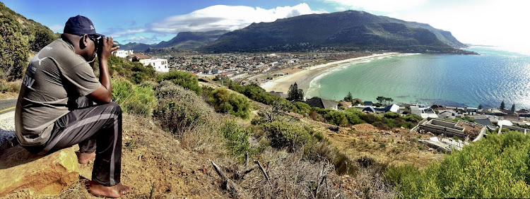 Shark Spotter Monwabisi Skweyiya on the mountain, high above Fish Hoek beach.