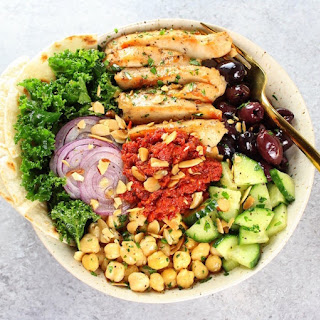 Chicken Kale Energy Bowl with Italian Sun-Dried Tomato Sauce.
