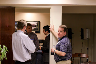 Photo: Chris Hurn's office is a natural magnet for folks to congregate. To learn more about what is going on at Mercantile Capital Corporation visit www.504log.com
