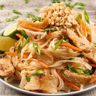 Chicken Pad Thai with carrots, roasted peanuts, and cilantro