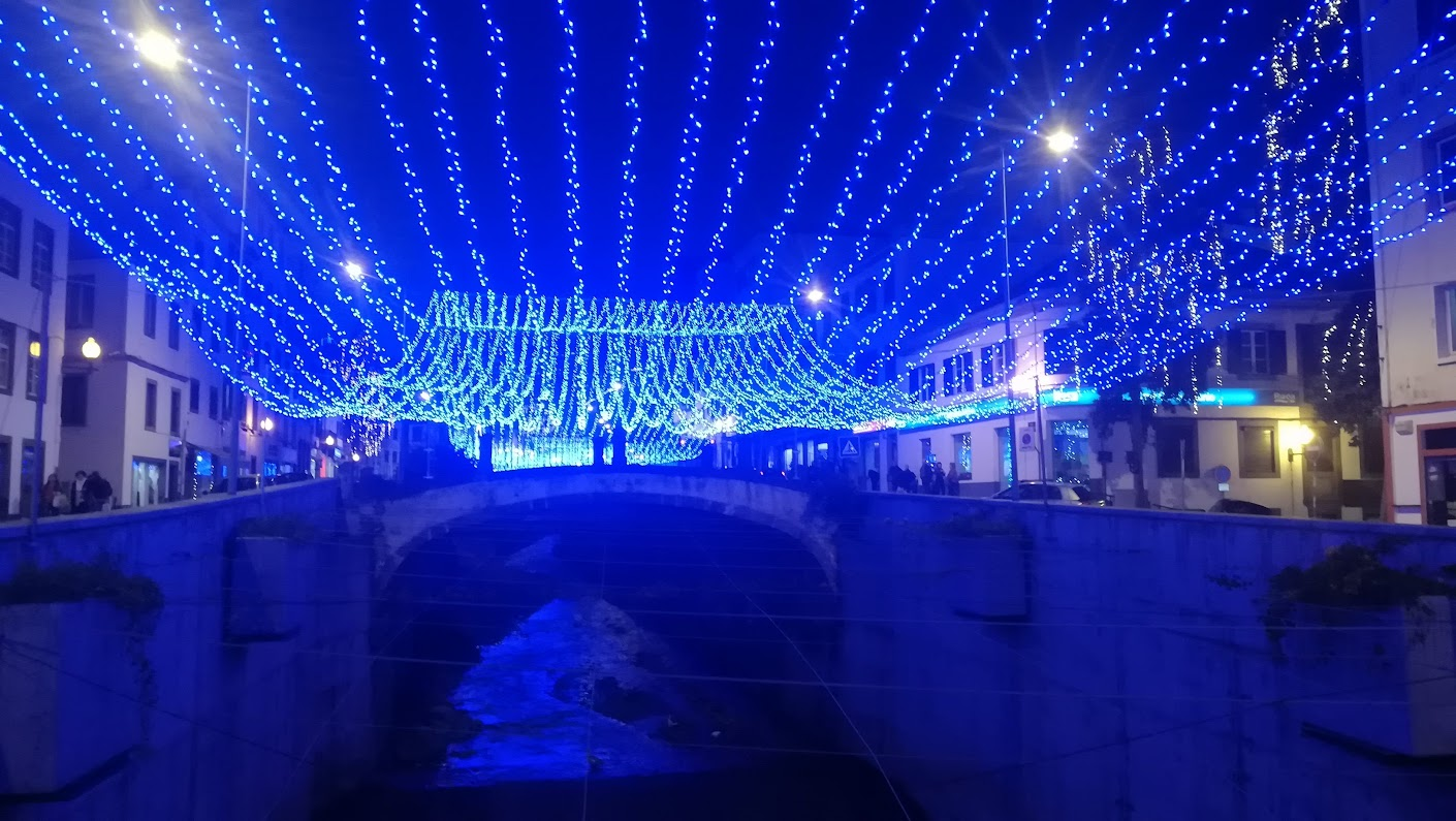 A river has a blue canopy at the Funchal Christmas lights.