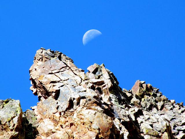 Moon over a rocky ridge