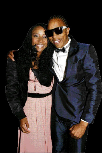 LIVING IT UP: Uyanda Mbuli with Tebogo Lerole at his birthday party in Sandton on Friday.  Pic. Mohau Mofokeng. 19/06/2010. © Sowetan.