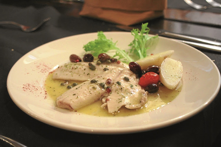 Alle Testiere. One of Venice's best eateries. Sea bream with lemon butter, capers and olives. Picture: MADELEINE MORROW