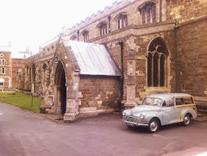 Photo: The church sign saying a funeral in progress, although I don't think the Moggy Traveller owner has gone into the hearse business..