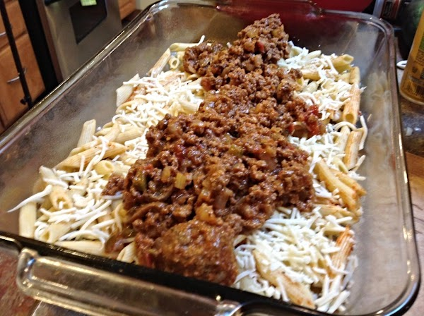 Add half of the meat mixture, spreading it out evenly over the top. Top...